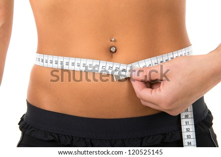 Young girl with piercing girl measuring her body for a perfect shape