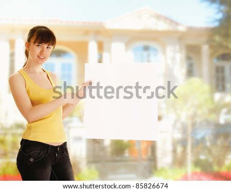 Young girl with pointing at  empty blank outdoors