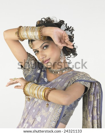 Young girl with rich bangles in nice hands expressions