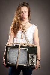young girl with rope holding retro television