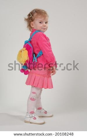 young girl with rucksack on the back