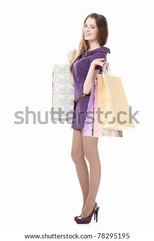 Young girl with shopping bags on a white background - stock photo