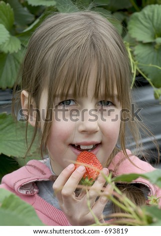 young girl with strawberries