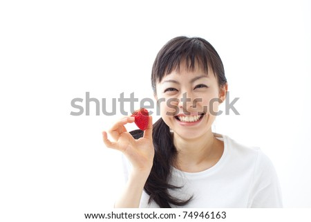 young girl with strawberries over white background