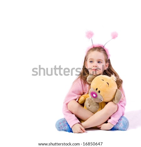 Young girl with toy on white background