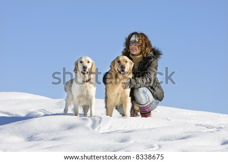Young girl with two dogs in the mountain