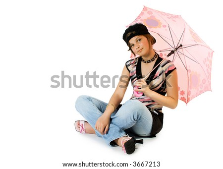 Young girl with umbrella sits on floor. Isolate on white.