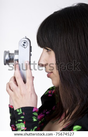 young girl with vintage camera from the side