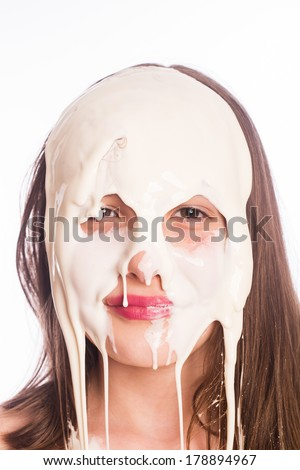 Young girl with white goop on her face.