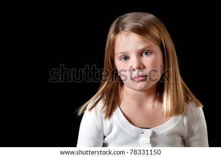Young girl with white sweater isolated on black with uninterested look
