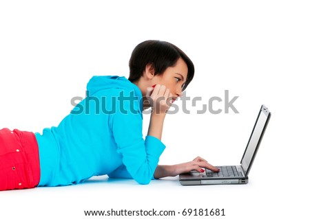 Young girl working on laptop isolated on white