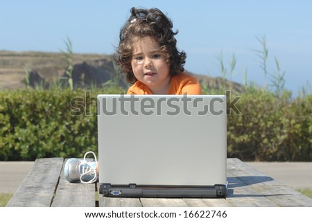 young girl working with laptop computer