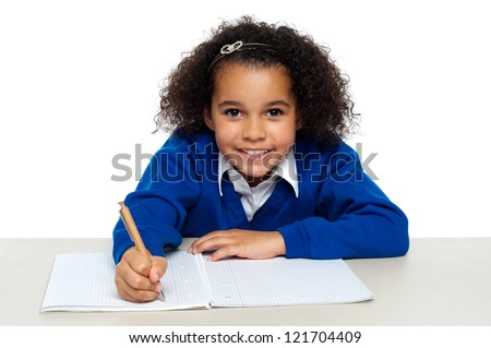 Young girl writing copying notes from the whiteboard. Isolated against white background.