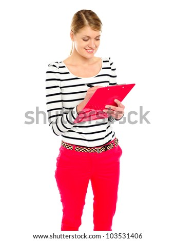 Young girl writing makes notes on clipboard. Isolated over white