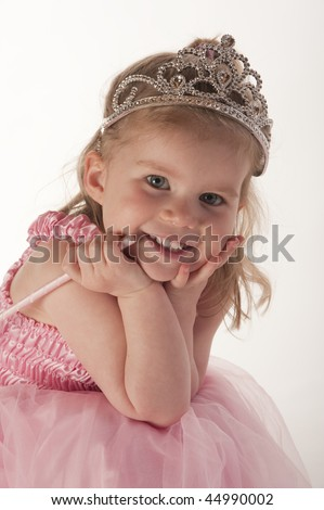 young girl (3 years old) dressed in fairy princess costume against white background