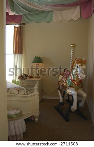 Young Girls Bedroom Interior Decorated With Carousel Ho