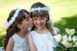 Young girls doing their catholic first holy communion