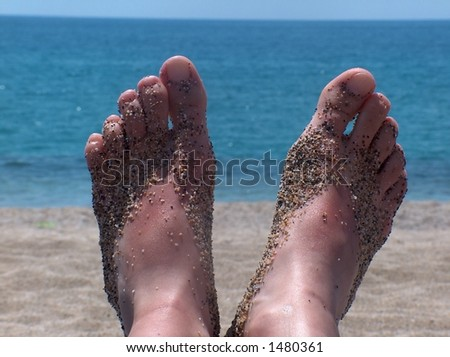 Young girls feet on a beach