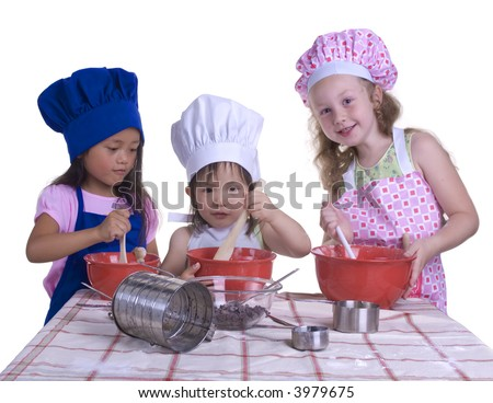young girls having fun in the kitchen making a mess....I mean making something special..... Education, learning, cooking, childhood