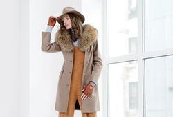 Young girls in coats posing at studio