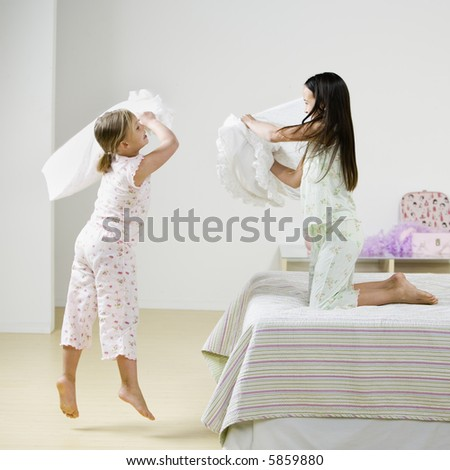 Young Girls Pillow Fighting