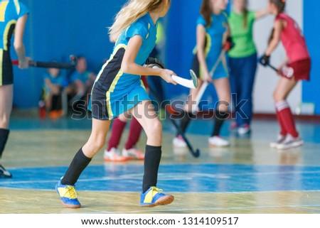 Young girls playing indoor hockey. Indoor hockey training #1314109517