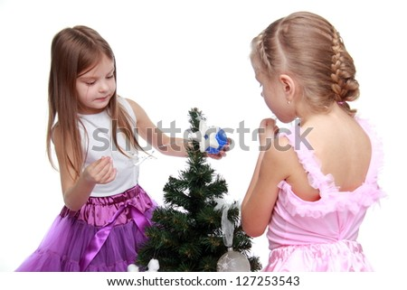 Young girls playing together on Holiday theme