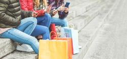 Young girls using smartphone web app for shopping online - Millennials women having fun with mobile phones - New female technology trends concept - Focus on close-up cellphone hands