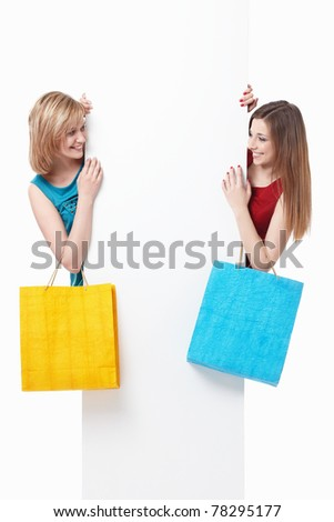 Young girls with their bags and empty the board on a white background