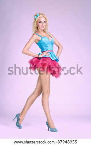 Young glamour barbie looking girl with long legs