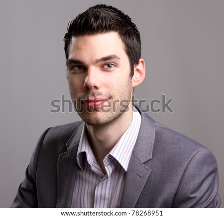 Young good looking suited man smiling for a close-up