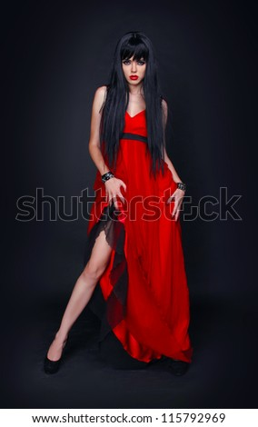 Young gorgeous Caucasian brunette in red dress, fashion
