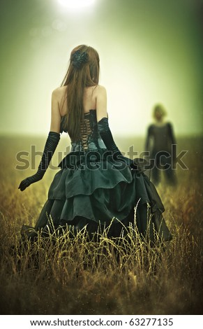 Young goth couple concept. Yellow and green tint. - stock photo