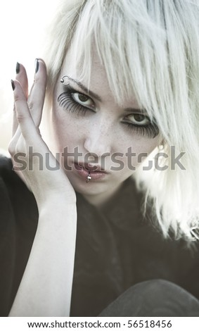 Young goth woman portrait. Soft white colors.