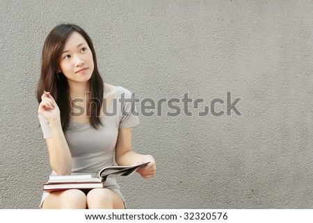 Young Graduate Thinking of Her Career Prospects