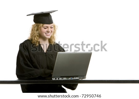 Young graduation girl on computer with white background