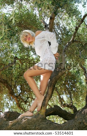 young Greek woman in an olive tree