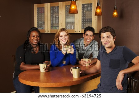 Young Group of Friends at the Cafe