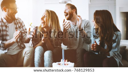 Young group of happy friends celebrating birthday