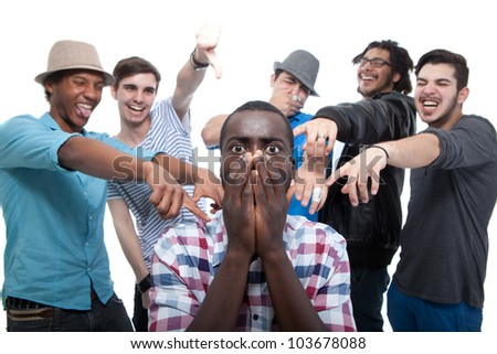 young group of men who are bullying one of them stock