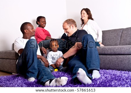 Young group of multiracial friends - two young families enjoying the afternoon.
