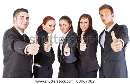 Young group of young business people showing thumbs up signs.