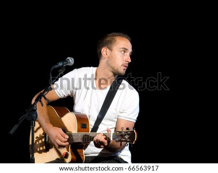 "Young guitarist holding guitar on a black background ... ""Prezzident "" band, Croatia."