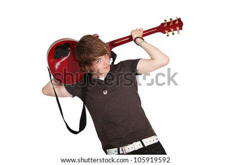 Young guitarist playing guitar behind his head, isolated on white