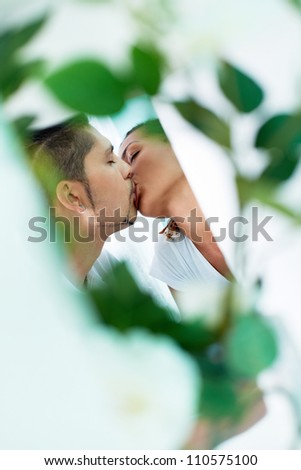 Young guy and his girlfriend sharing passionate kiss