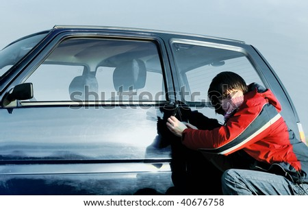 Young guy braking door of a car and looking back