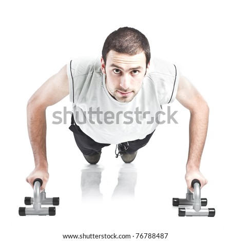 Young guy doing push ups isolated on white background