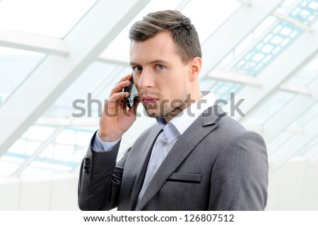 young guy enjoying a conversation over the cellphone