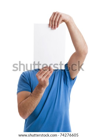 Young guy holding a blank bill board over face isolated on white