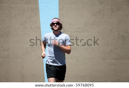 Young guy jogs for exercise